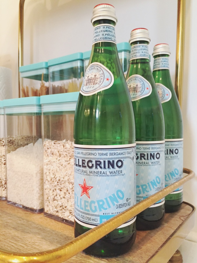 bar cart pantry in Tiny Kelsie's bright & kitschy kitchen
