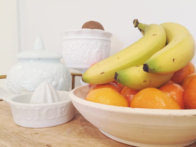 produce in Tiny Kelsie's bright & kitschy kitchen