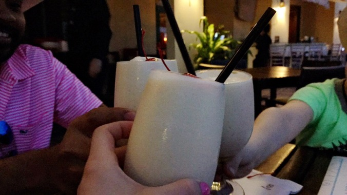 Pina colada cheers at Sheraton Old San Juan in Puerto Rico