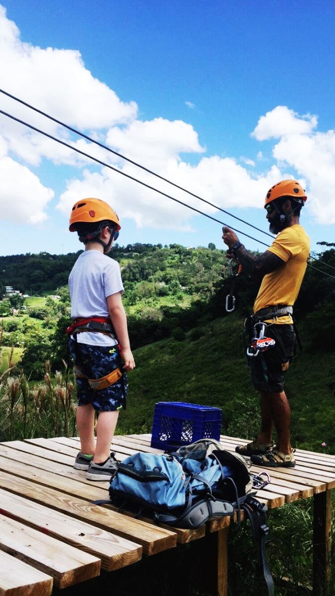 seven year old ziplining over the rainforest in puerto rico