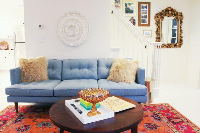 TinyKelsie living room progress with circle weave and mid century couch