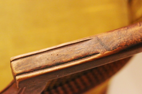 damaged wooden arms on upholstered chair painted with textile medium