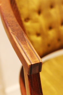 damaged wooden arms on upholstered chair