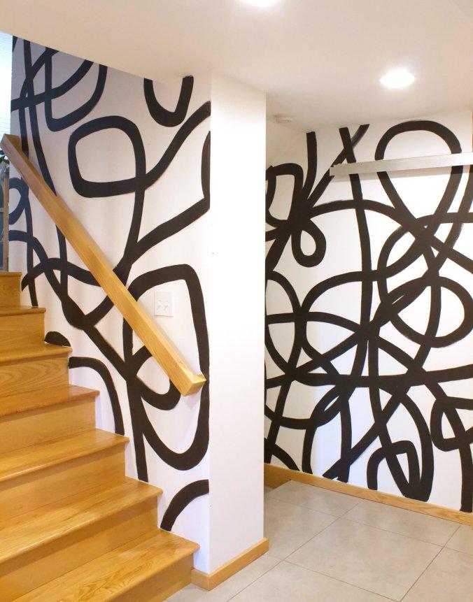 ashley mary black white brushtroke mural
