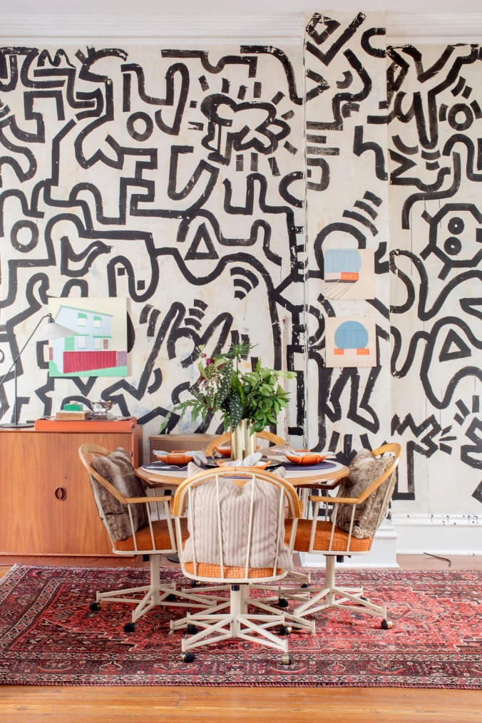 keith haring inspired black and white graphic brushstroke mural